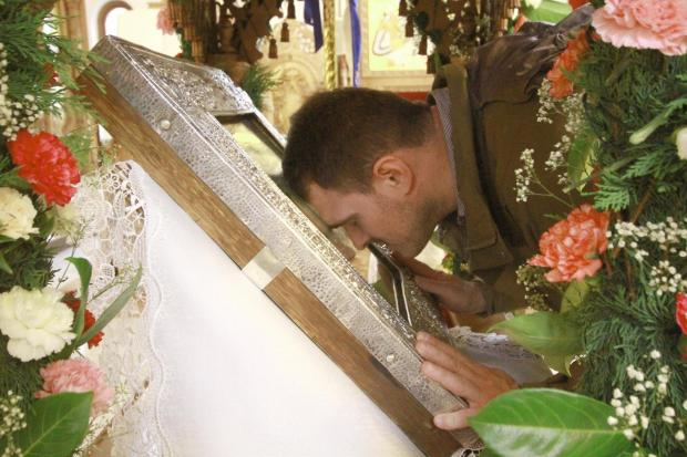 People travelled from across the region to touch, kiss and pray to the fragment of the True Cross