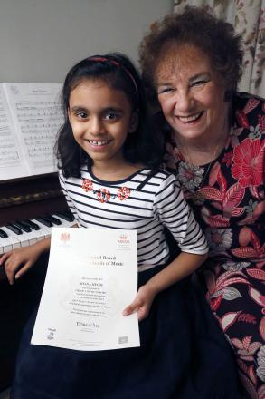 Ahana Hegde with piano teacher Mignonette Aarons