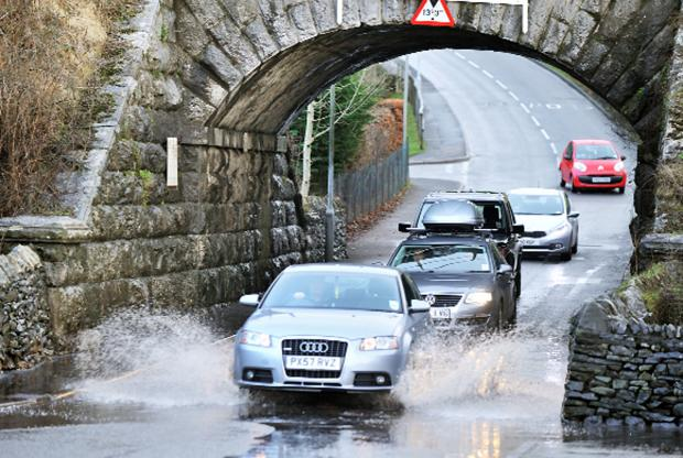 Harrow Times: Drivers negotiate the flooding at Parkside Road