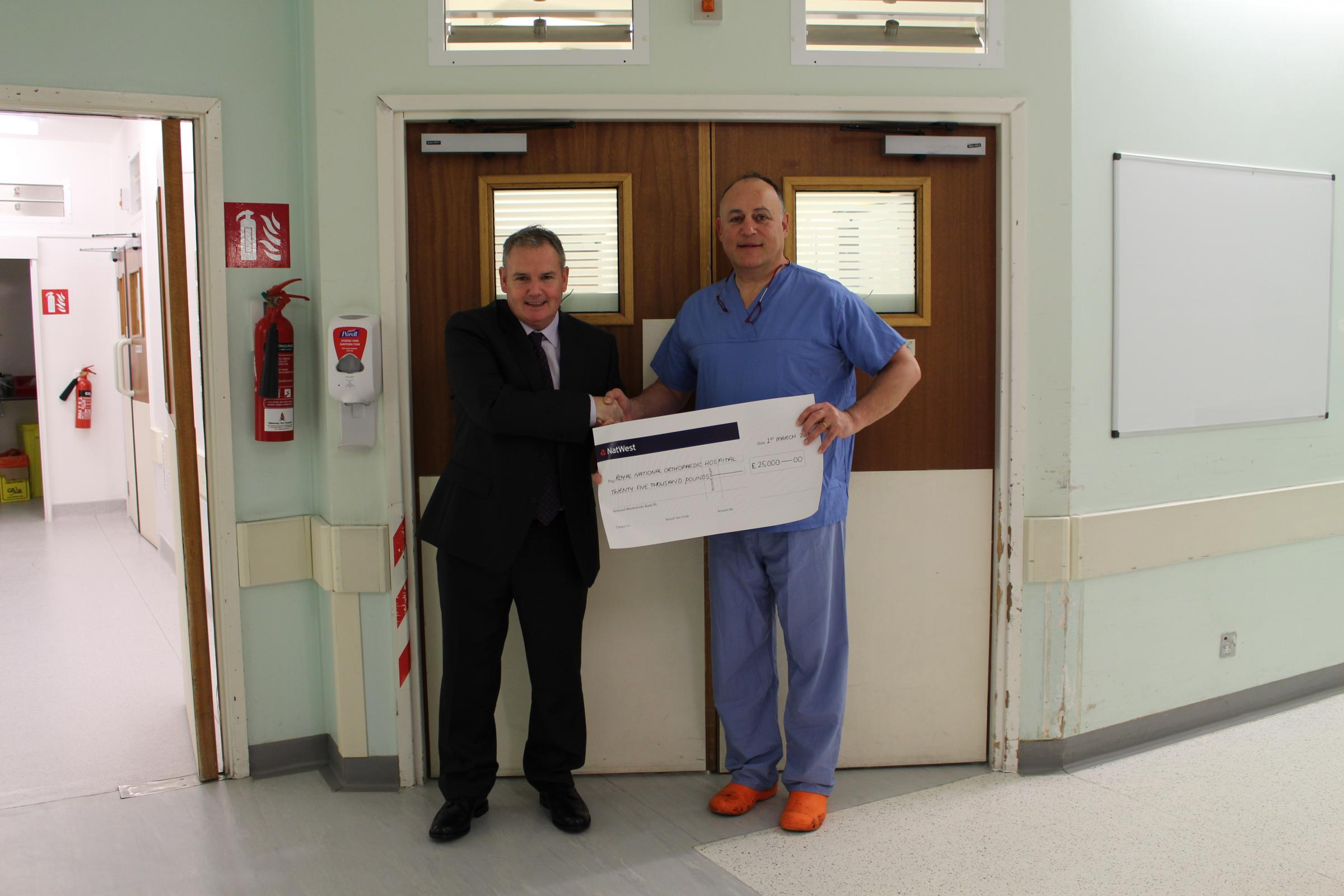 Declan Kelly presented a cheque worth £25,000 to Professor Tim Briggs of the  Royal National Orthopaedic Hospital