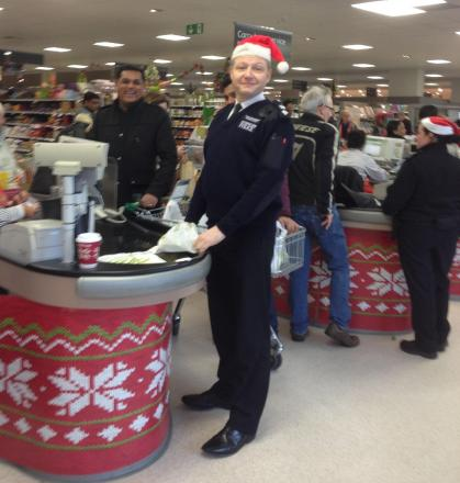 Borough Commander Simon Ovens packed bags at a supermarket in South Harrow to raises money for the First Stanmore Troop Girls Brigade