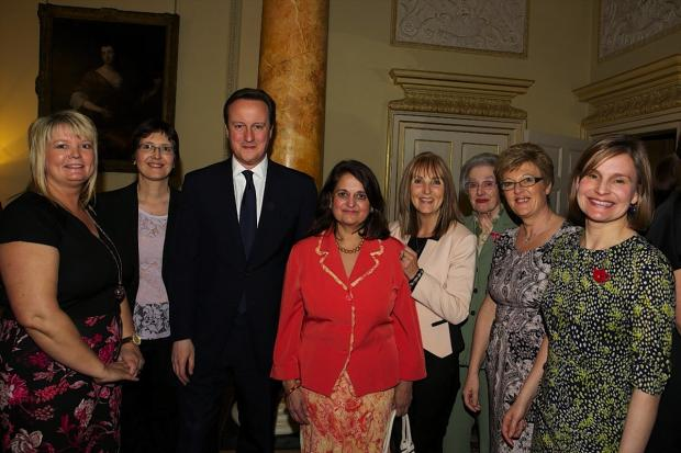 Harrow Times: Ranu Mehta-Radia (fourth from left) with Prime Minister David Cameron and fellow mums of the year Diana Golding, Jane Plumb, Maggie Hughes, Pamela Clark, Lynn McManus and Laura Young