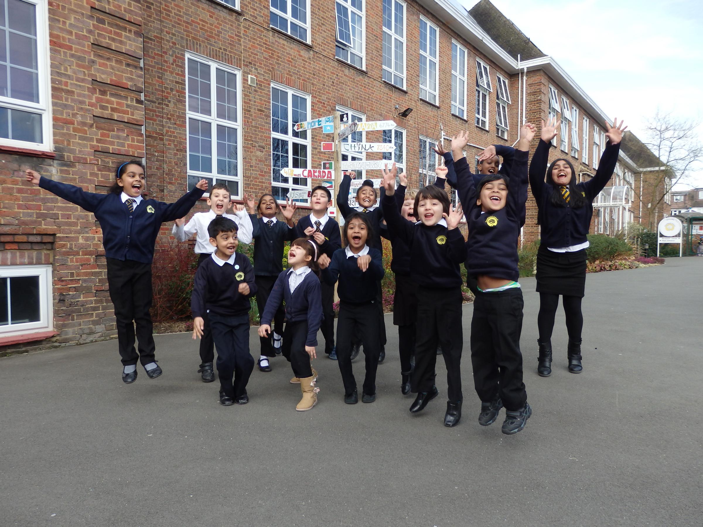 Children at Heathland School in South Harrow celebrate an 'outstanding' Ofsted inspection