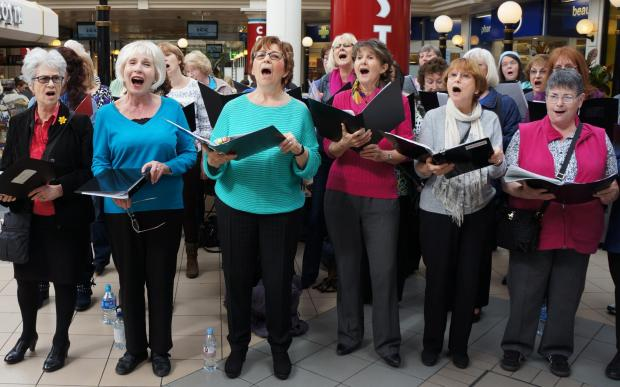 Choir performs for shoppers