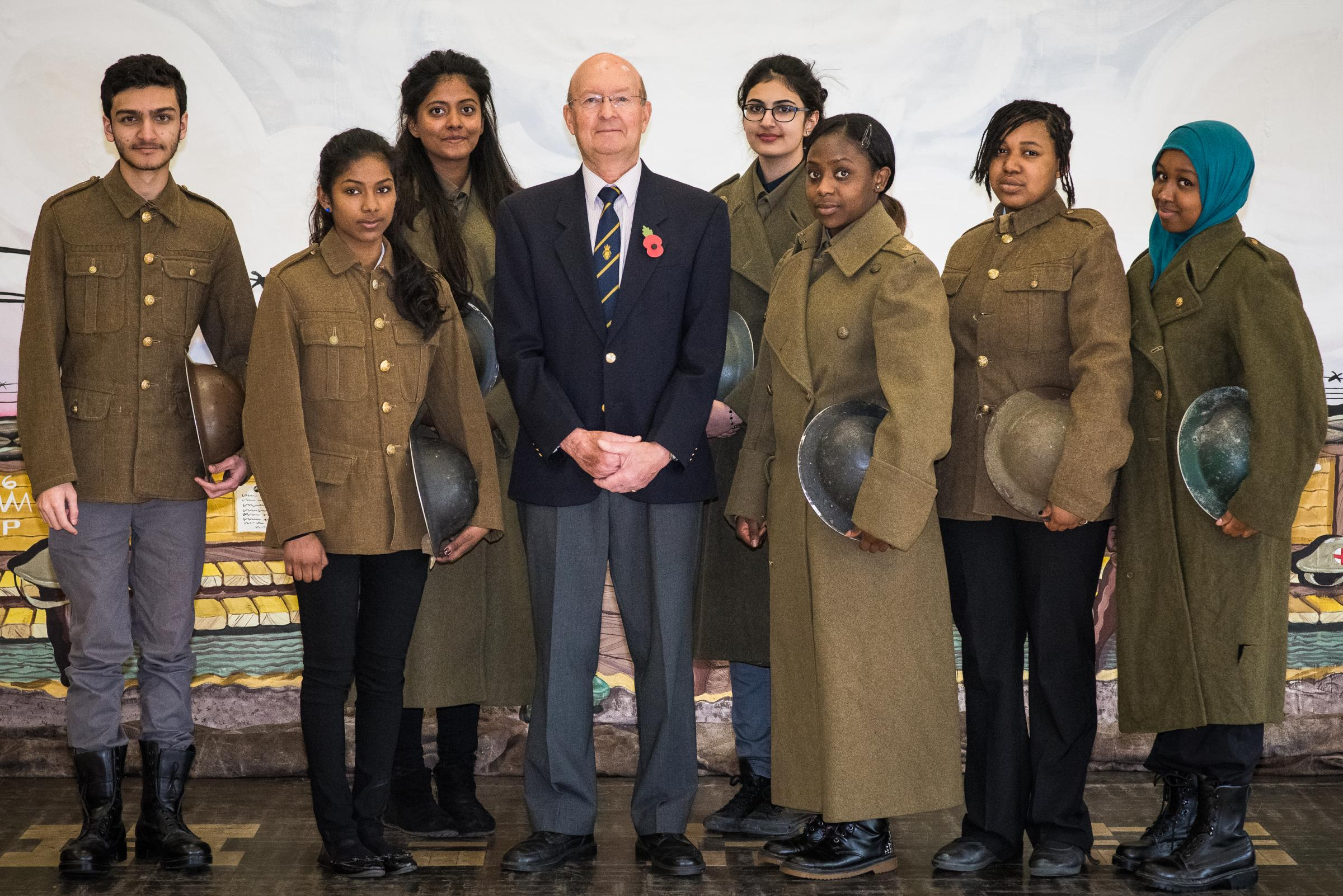 Pupils with Tony Walton of The Royal British Legion Poppy Appeal. Photograph by Steve Foster