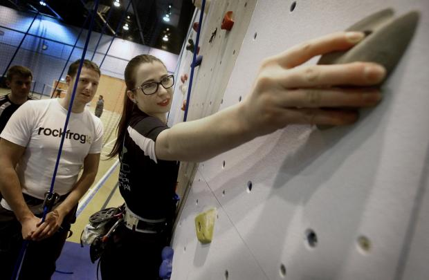 Damon Clark encourages competition climber Jess Thorne at the opening of the new wall
