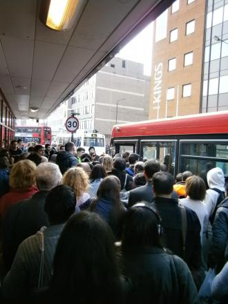 Commuters crammed onto buses to complete their journey home