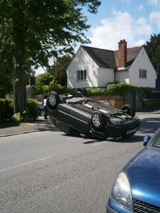 Overturned car closes road