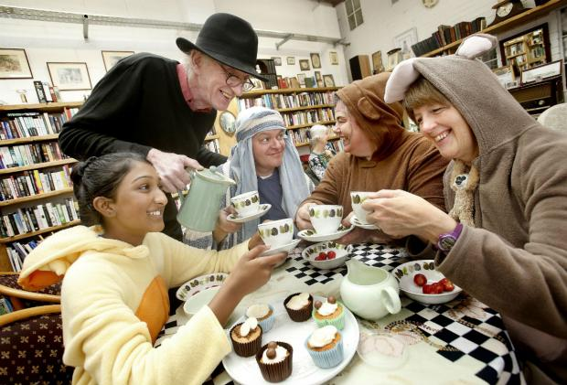 Harrow Times: Fourteen-year-old Shelina Devendra shares tea and cake with Peter Carlson, Peter Davenport, Teresa Davenport and Jane Buxton.