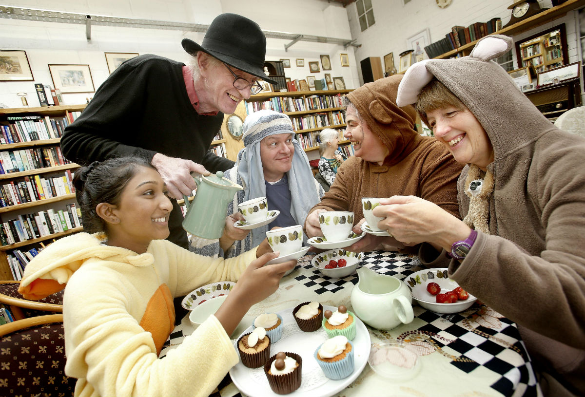 Fourteen-year-old Shelina Devendra shares tea and cake with Peter Carlson, Peter Davenport, Teresa Davenport and Jane Buxton.