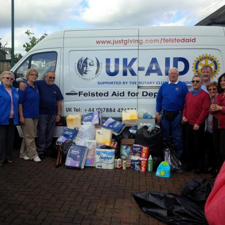 Rotary Club loads up donated goods for deprived children