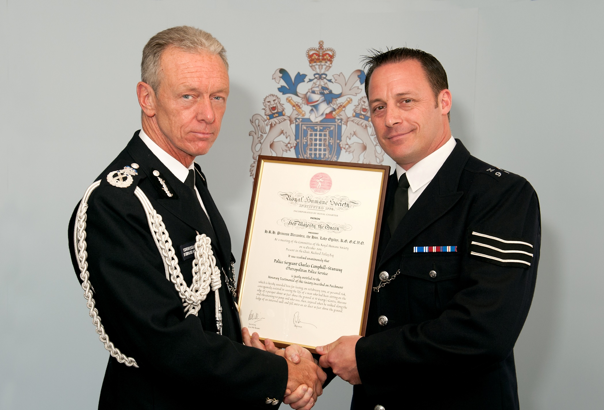 Met Commissioner Sir Bernard Hogan-Howe and Police Sergeant Chas Campbell-Stanway