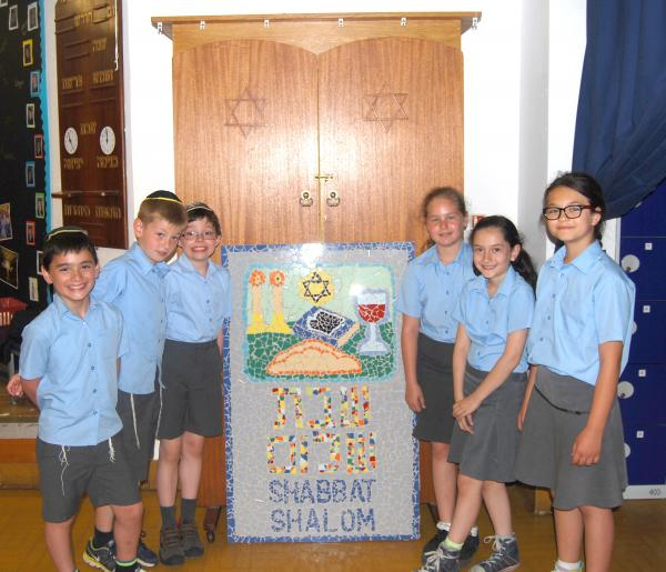 Pupils create mosaic for charity care village
