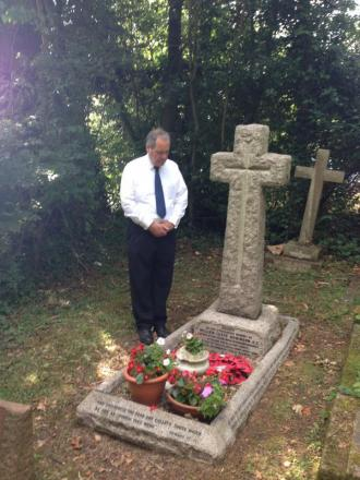 Bob Blackman at the grave of Leefe Robinson VC