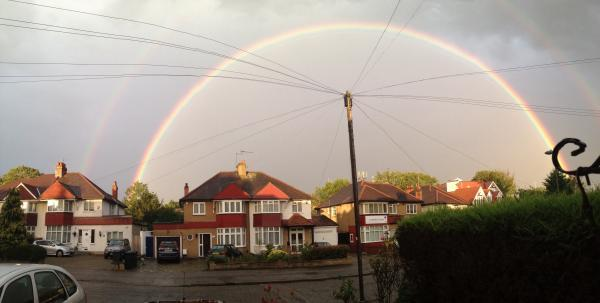 Double rainbow brings splash of colour after torrential downpour