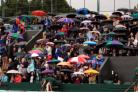 Rain was falling at Wimbledon on day five