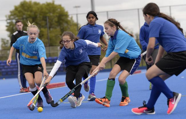 Students From Whitmore High School Battle It Out In Hockey Schools