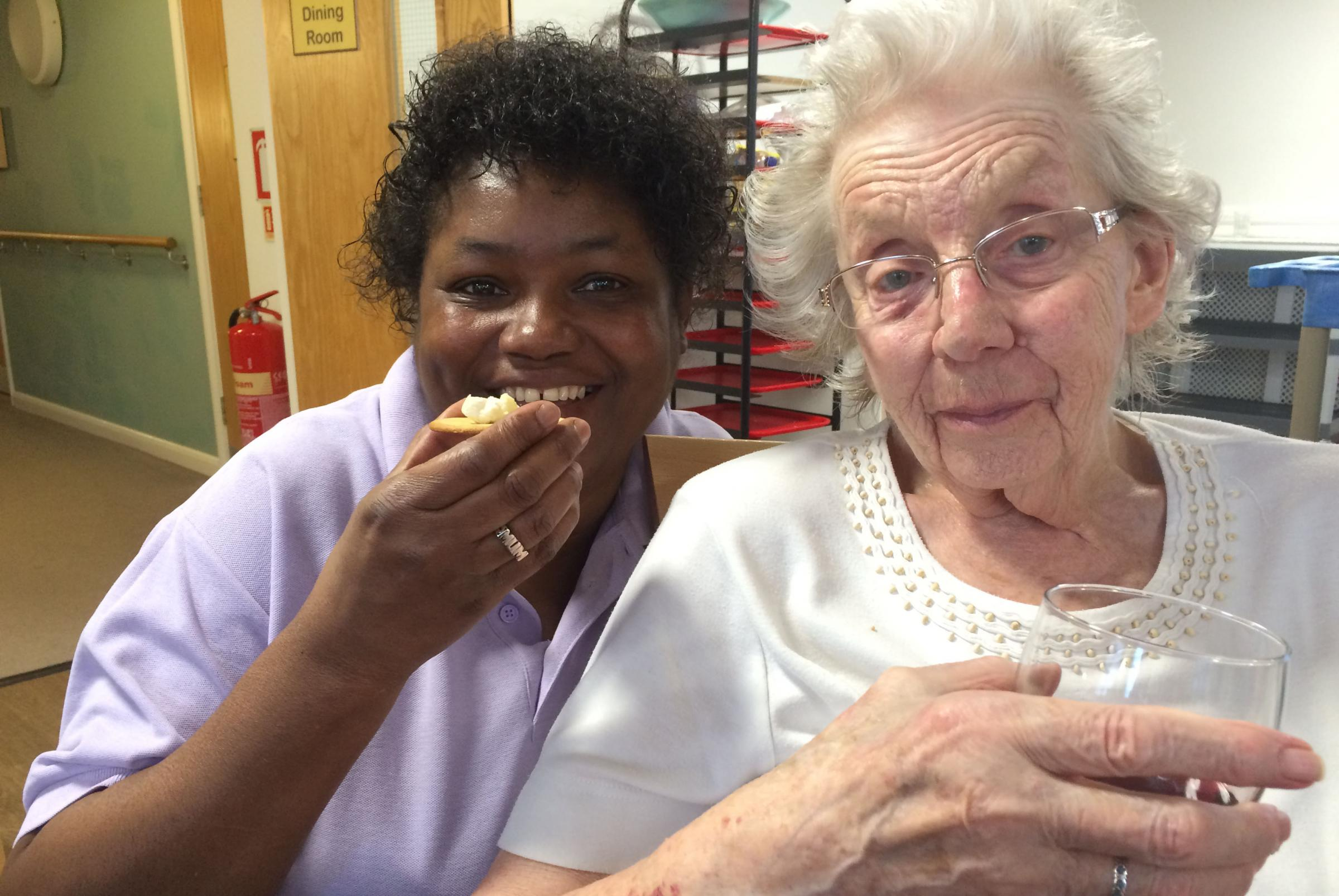 Care assistant Yvonne Roberts and resident Mary Woolcott