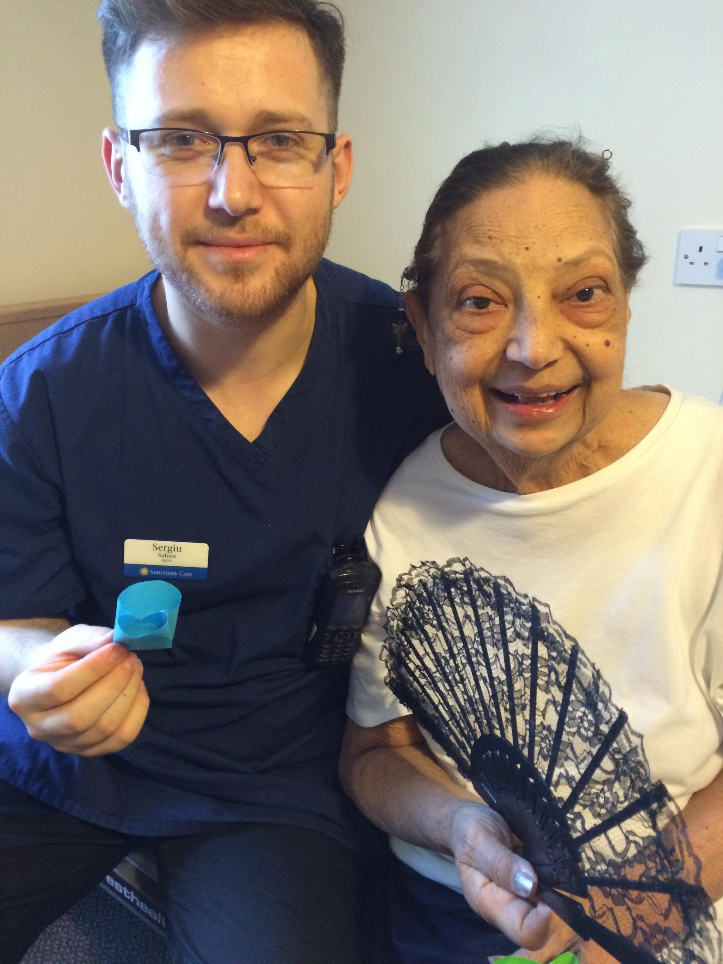 Nurse Sergiu Sabou with care home resident Lillian Galpern