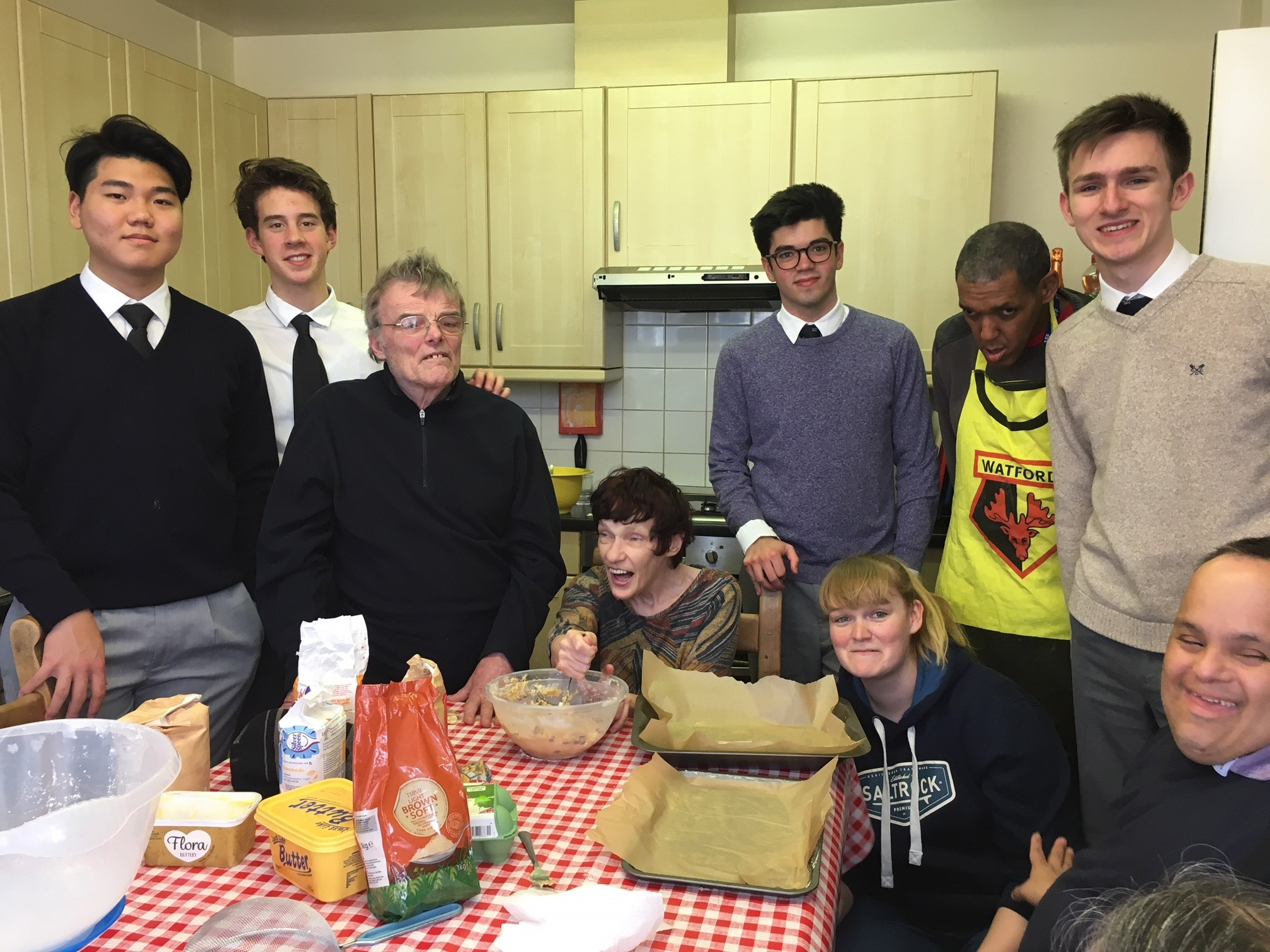 Pupils from Harrow School and residents of Certitude during the cooking project