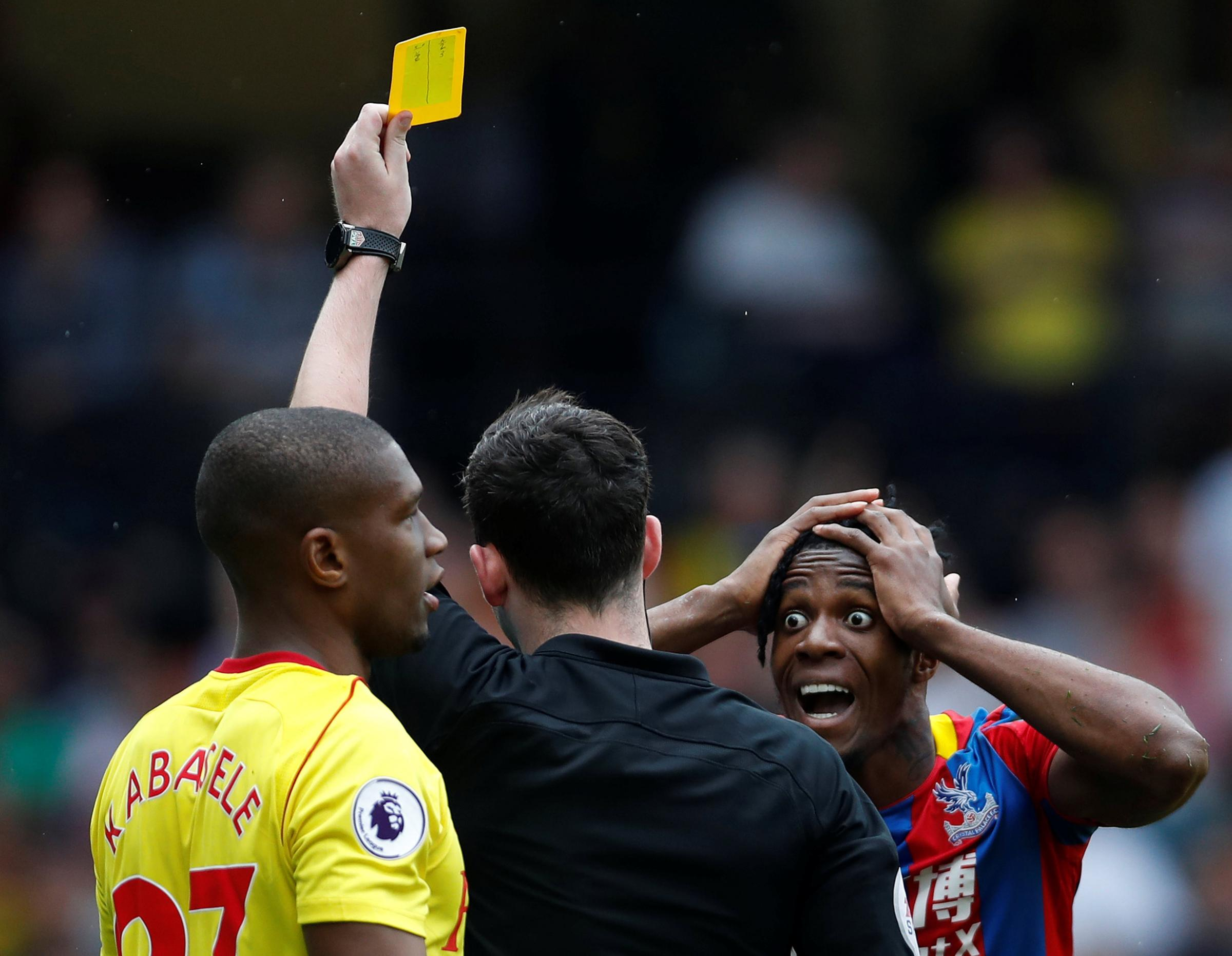 Wilfried Zaha can't believe he's being booked for simulation by referee Chris Kavanagh. Pictures: Action Images