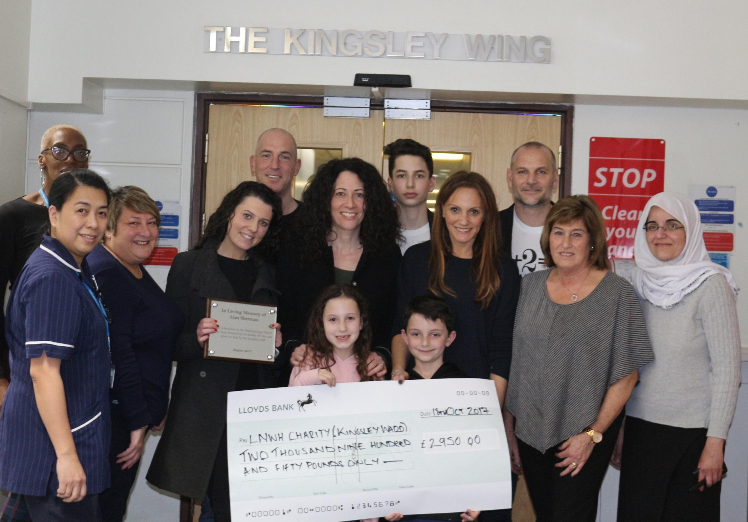 The family presented the nearly £3,000 cheque to the ward last week