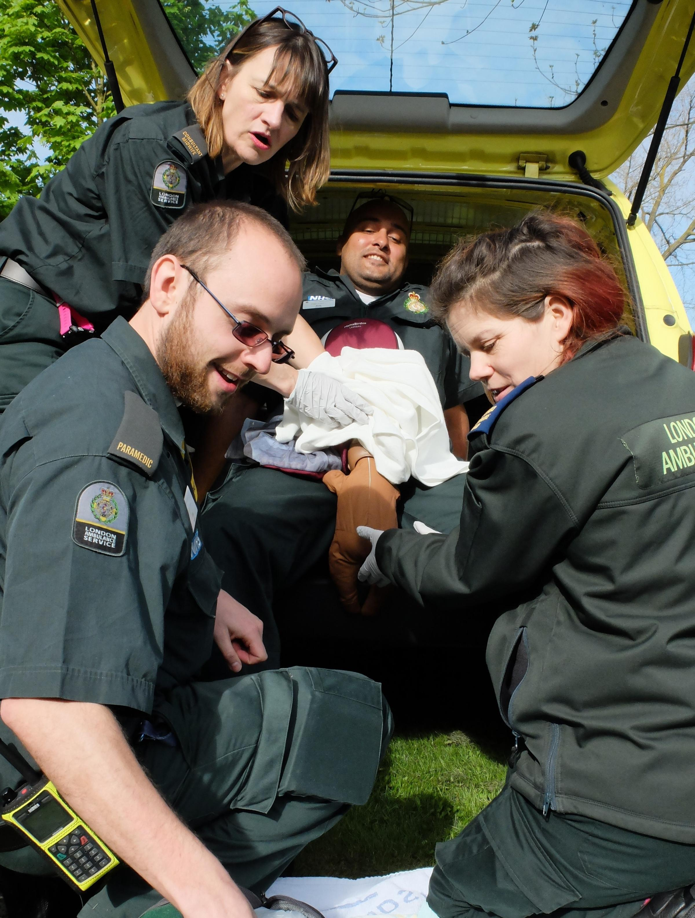 Ambulance team leader in simulated birth during training exercise