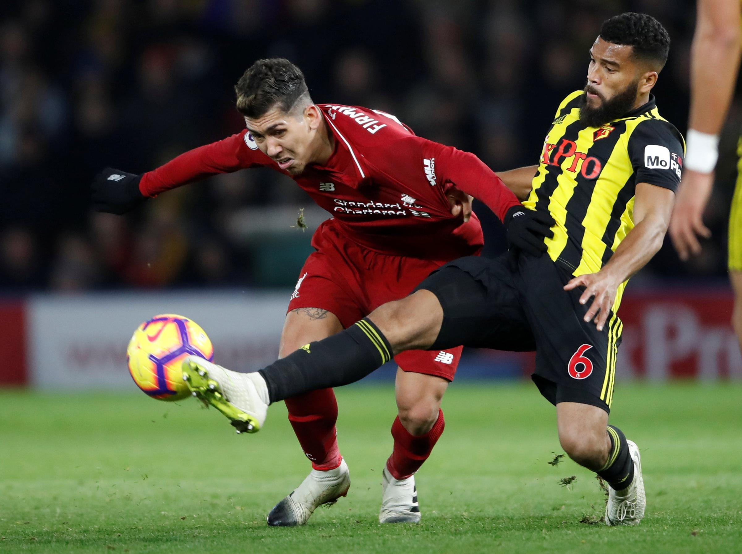 Adrian Mariappa beats Roberto Firmino in a challenge. Picture: Action Images