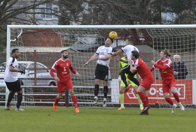Kings Langley are forced to head clear during their 4-3 victory over Harrow Borough on Saturday. Picture: Len Kerswill