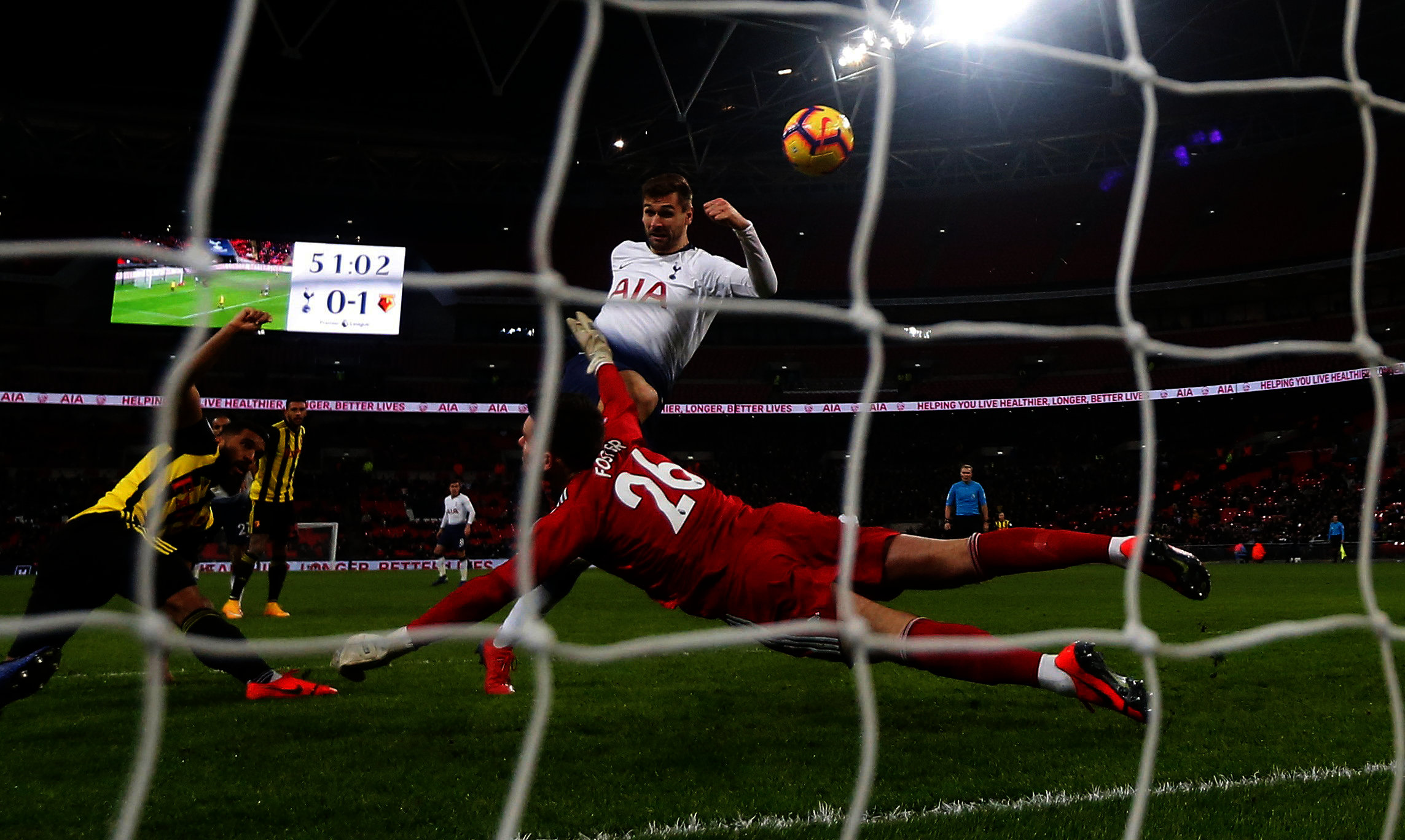 Ben Foster throws himself at Fernando Llorente. Picture: Action Images