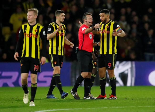 Paul Tierney explains a decision to Troy Deeney. Picture: Action Images