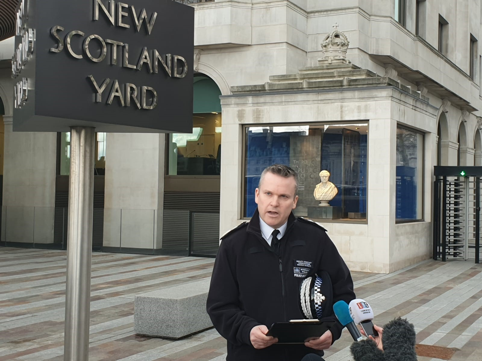 Deputy Assistant Commissioner Graham McNulty making a statement on violence outside Scotland Yard