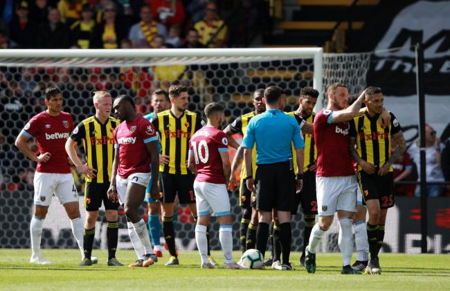 Marko Arnautovic consoles Jose Holebas following his red card. Picture: Action Images