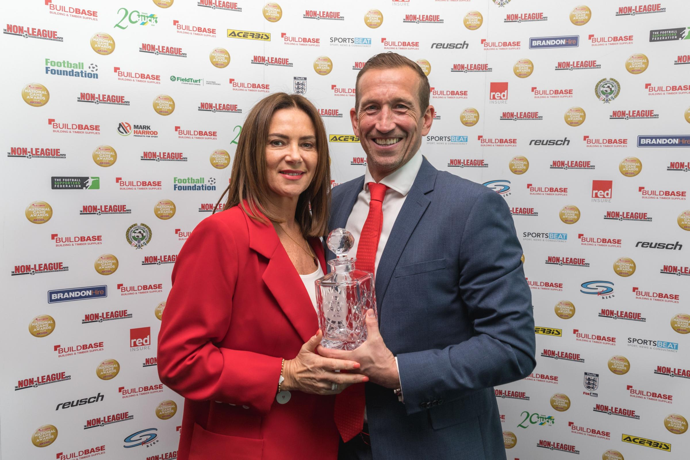 Justin Edinburgh picked up his award at Stamford Bridge